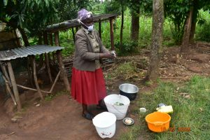 The Water Project:  Josephine Washes Utensils With Water From Indangasi Spring