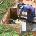 The Water Project: Emulembo Community, Gideon Spring -  Everlyne Fetches Water At Gideon Spring