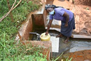 The Water Project:  Everlyne Fetches Water At Gideon Spring