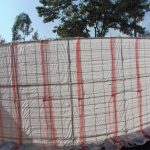 The Water Project: Mutiva Primary School -  Tank Covered With Empty Sacks