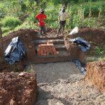 The Water Project: Ewamakhumbi Community, Mukungu Spring -  Spring Slab Setting