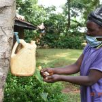 The Water Project: Emulembo Community, Gideon Spring -  Everlyne Washes Her Hands With Soap At Home