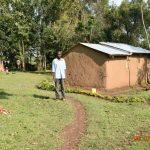 The Water Project: Munenga Community, Burudi Spring -  Silas Burudi Outside His Home