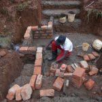 The Water Project: Ewamakhumbi Community, Mukungu Spring -  Wall Construction