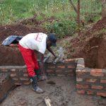 The Water Project: Ewamakhumbi Community, Mukungu Spring -  Pipe Setting
