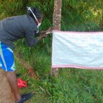 The Water Project: Shihingo Community, Mulambala Spring -  Mrs Wagaka Mounting The Chart At The Water Point
