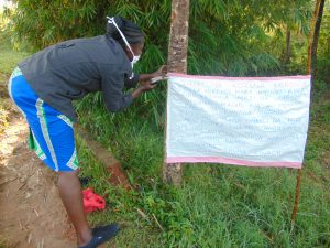 The Water Project:  Mrs Wagaka Mounting The Chart At The Water Point