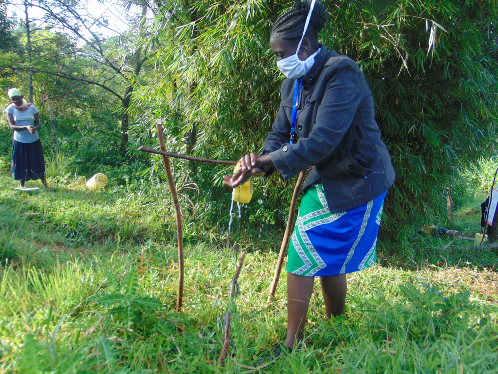 The Water Project : covid19-kenya18089-the-facilitator-leading-the-handwashing-exercise