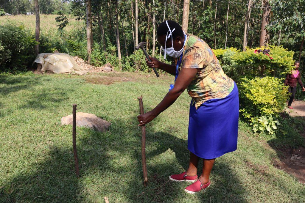 The Water Project : covid19-kenya18097-setting-up-handwashing-station