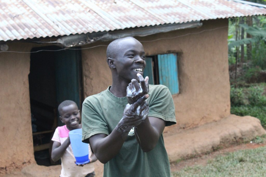 The Water Project : covid19-kenya18104-happy-young-man