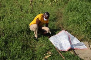 The Water Project:  Mr Mutai Mounting The Chart To Support Poles