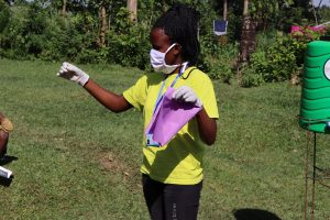 The Water Project:  Ms Gladys Showing The Community Members A Simple Way Of Making A Mask