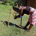 The Water Project: Musango Community, Dawi Spring -  Ms Jemimah Using The Tippy Tap