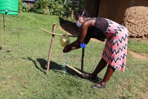 The Water Project:  Ms Jemimah Using The Tippy Tap