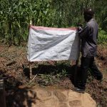 The Water Project: Mwituwa Community, Shikunyi Spring -  Installing Reminder Chart At The Spring