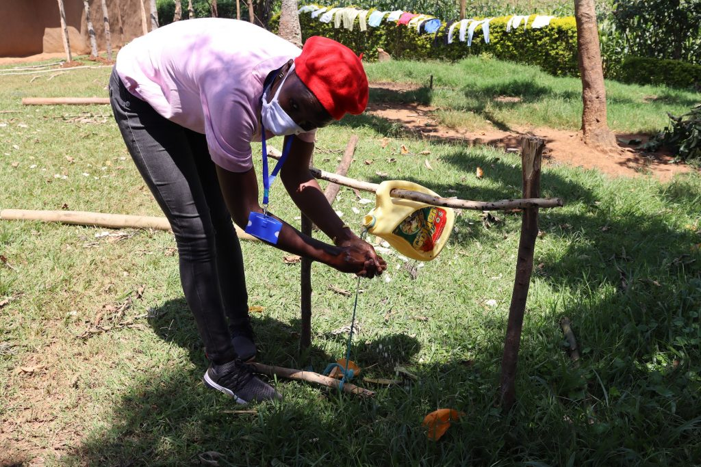 The Water Project : covid19-kenya18108-training-on-how-to-use-tippy-tap-handwashing-stations