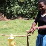 The Water Project: Mwituwa Community, Nanjira Spring -  A Community Member Following Handwashing Steps