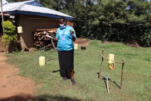 The Water Project:  Facilitator Directing How To Use A Handwashing Station