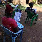 The Water Project: Mwituwa Community, Nanjira Spring -  Participants Following Training Using Handouts
