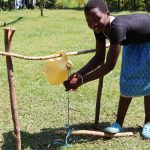 The Water Project: Mwituwa Community, Nanjira Spring -  Using Installed Handwashing Point