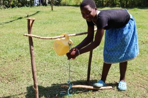 The Water Project:  Using Installed Handwashing Point