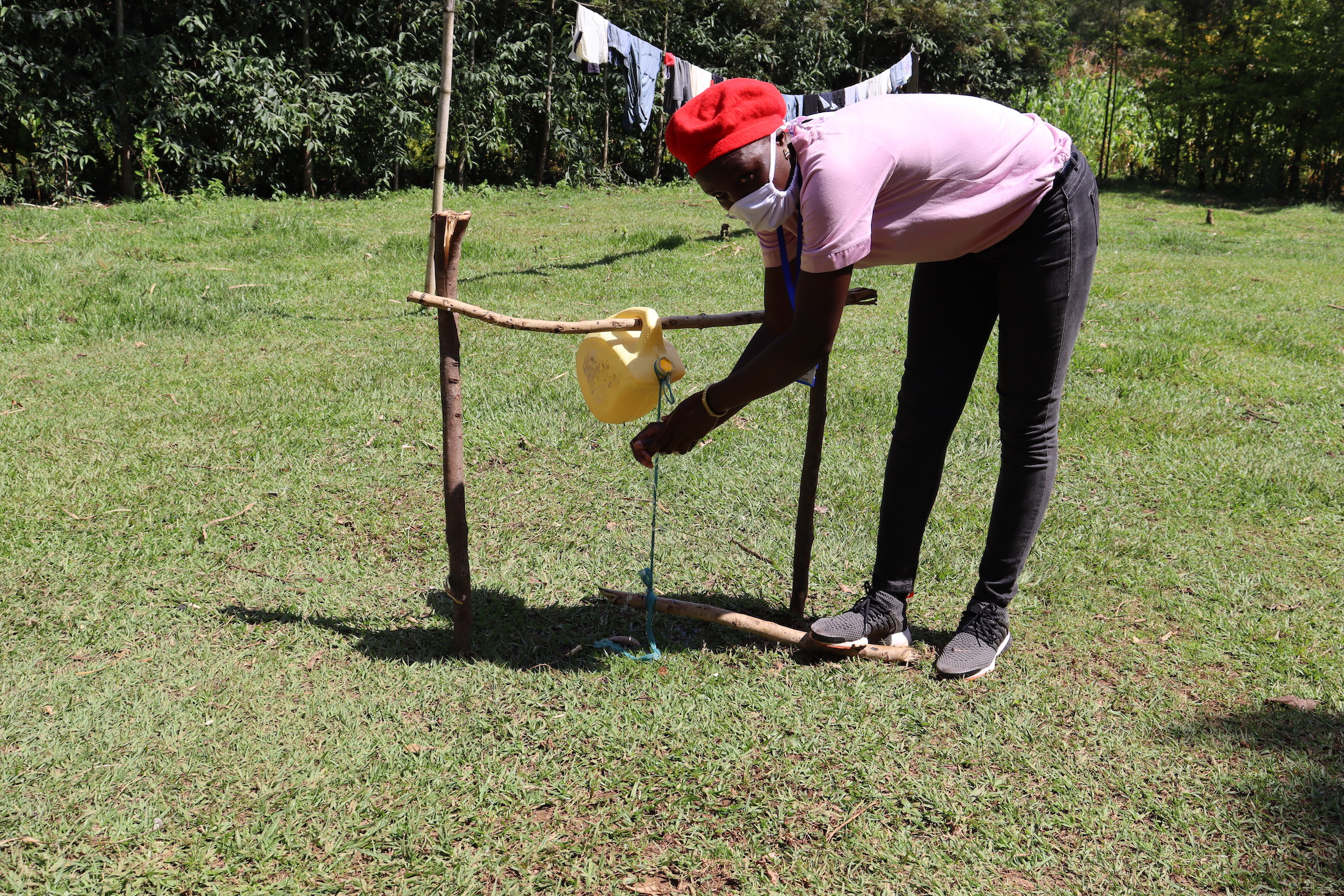 The Water Project : covid19-kenya18109-demonstration-on-using-the-installed-handwashing-station
