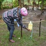 The Water Project: Burachu B Community, Shitende Spring -  Using Handwashing Station