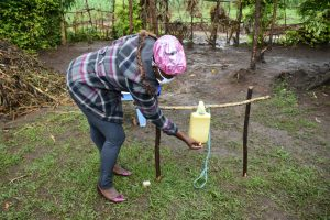 The Water Project:  Using Handwashing Station