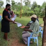 The Water Project: Ataku Community, Ataku Spring -  Ms Betty Handing Out The Training Aids