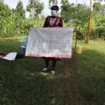 The Water Project: Ataku Community, Ataku Spring -  Ms Wagaka Holding Up The Chart