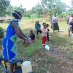 The Water Project: Handidi Community, Chisembe Spring -  Ms Wagaka Leading Handwashing Training