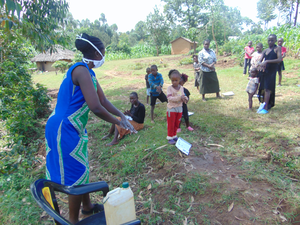 The Water Project : covid19-kenya18127-ms-wagaka-leading-handwashing-training