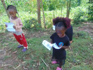 The Water Project:  Two Girls Reading Through The Documents