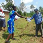 The Water Project: Handidi Community, Chisembe Spring -  Handing Out The Training Aids