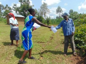 The Water Project:  Handing Out The Training Aids
