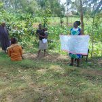 The Water Project: Handidi Community, Chisembe Spring -  Training Using The Prevention Chart