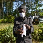 The Water Project: Esembe Community, Chera Spring -  Demonstrating How To Make A Mask