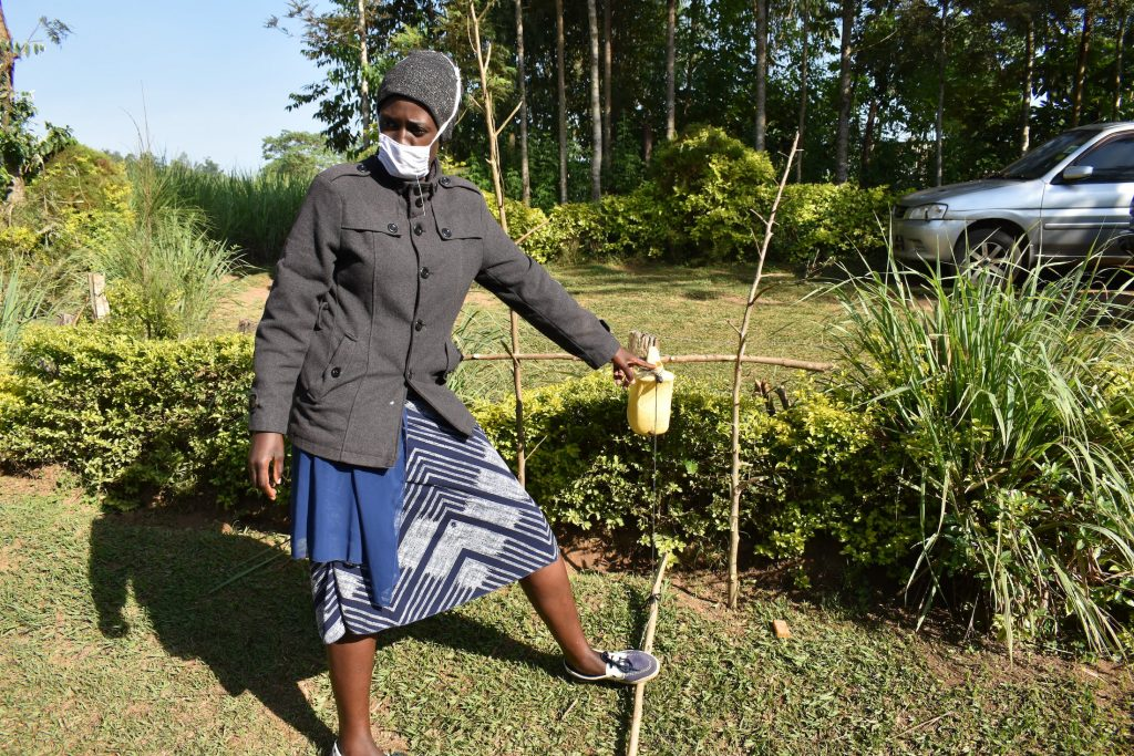 The Water Project : covid19-kenya18131-demonstrating-how-to-use-the-tippy-tap