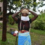 The Water Project: Burachu B Community, Maji Mazuri Spring -  A Communityy Member Trys On The Sewn Cloth Mask