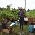 The Water Project: Burachu B Community, Maji Mazuri Spring -  Distributing Training Manuals To Participants