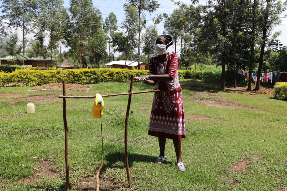 The Water Project : covid19-kenya18133-the-facilitator-demonstrating-handwashing