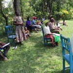 The Water Project: Muyundi Community, Baraza Spring -  A Community Member Addressing The Group
