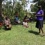 The Water Project: Muyundi Community, Baraza Spring -  A Leader Addressing The Group