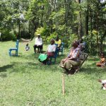 The Water Project: Muyundi Community, Baraza Spring -  Reviewing The Prevention Reminders Chart