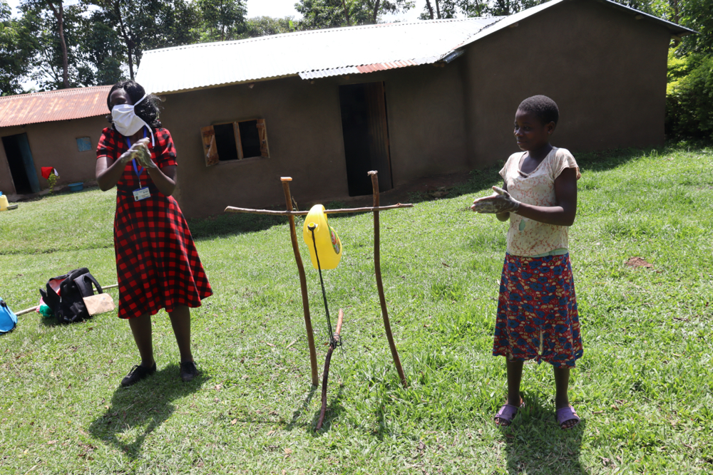 The Water Project : covid19-kenya18142-demonstrating-the-ten-steps-of-handwashing