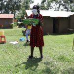 The Water Project: Muyundi Community, Baraza Spring -  Mask Making Demonstration