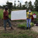 The Water Project: Muyundi Community, Ngalame Spring -  Reviewing Prevention Reminders Chart