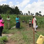 The Water Project: Muyundi Community, Ngalame Spring -  Team Leader Catherine Addressing The Community