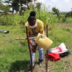 The Water Project: Muyundi Community, Ngalame Spring -  The Facilitator Using The Tippy Tap