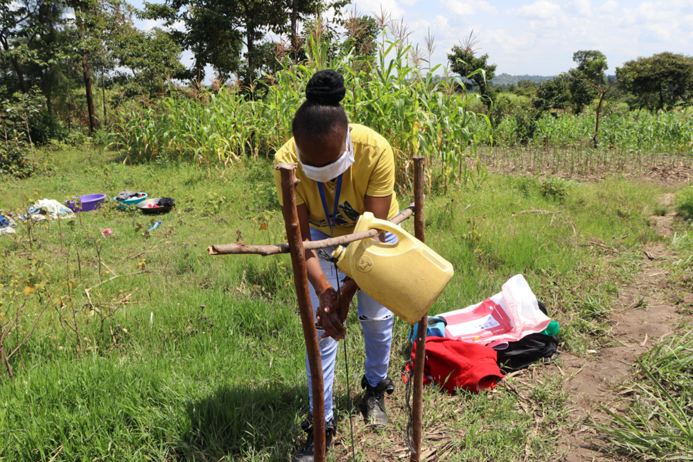 The Water Project : covid19-kenya18143-the-facilitator-using-the-tippy-tap